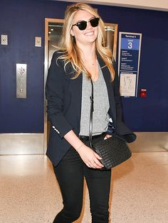Kate Upton kept her look casually chic with a gray tee, a navy blazer, perfectly blown-out tresses and classic Clubmaster sunnies!