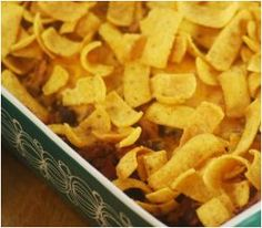 Kid-Friendly Frito Pie - This slow cooker casserole recipe serves 8, so you can bring it for a potluck, or serve it for a weeknight meal with leftovers. I didn't make it into a pie, because with just two people, I knew it would get soggy, but my husband loved the chili (even though he's always saying he doesn't like chili with beans). We just topped our individual bowls with cheese and Fritos.