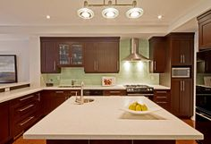 green and brown transitional kitchen by Eurodale Developments Inc