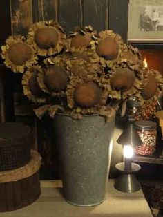 Sunflowers in an old bucket - not dollies but a lovely primitive display
