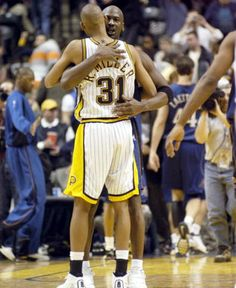 A farewell hug from Reggie Miller for his longtime rival, Michael Jordan, after Jordan's final game in Indianapolis.