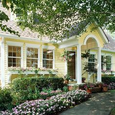 I am showing little yellow houses today. Little yellow farm house, yellow house with window boxes and white picket fence, yellow house exterior color ideas. Yellow House Exterior, House Paint Exterior, Exterior Paint Colors, Paint Colors For Home, Exterior Design, Paint Colours, Exterior Shutters, Cottage Living, Cottage Homes