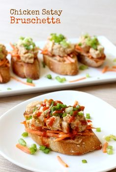 Spicy and nutty chicken satay on top of toasted baguette slices - an app that eats like dinner!