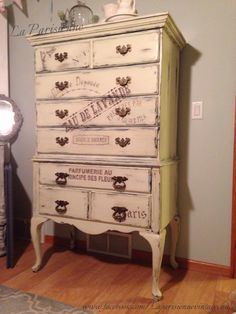 One of a kind Highboy with beautiful Queen Anne legs. Refinished in CeCe Caldwell's Paints in Texas Prairie Green antiqued & distressed. I added some beautiful French Typography. This is a solid dresser with smooth functioning drawers and brass hardware. Such a beautiful piece, made by Bombay House Company. CeCe Caldwell Chalk & Clay Paint is 100% Natural, it is safe for your family & the environment. It is Made in the USA.