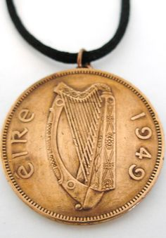 Authentic 1949 Irish Penny Birth Year necklace.  The necklace showing the 16 string Irish harp modelled on the Brian Boru harp in Trinity College Dublin,with the year(1949) on the right side and eire on the left of the harp.  On the reverse side is the Penny/Hen and Chickens/Pingin designed by the English artist Percy Metcalf. The penny was first struck in 1928 and was last struck in 1968.  You have to love this large copper coin,a mother hen with her chicks! Perfect reminder of Iri...