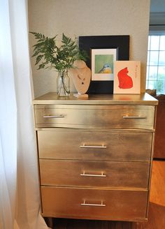 Gosh doggit, I've GOT it! I'm going to take that boring old ugly Ikea dresser DK won't let me get rid of, put small legs on it and paint it GOLD! Whoa! (And drawer pulls too)