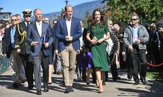Prince William and Kate arrived at UBC Okanagan to rapturous applause from spectators outside the campus. Kate wore a customized Dolce & Gabbana dress with nude pumps and a nude clutch, while William looked cool and casual in a blue jacket and khaki pants. <br><br>Photo: © Tim Rooke/Shutterstock