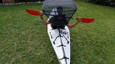 A canopy to keep you in the shade on your fold up kayak! Both are easily portable. Just put a bimini top on the fold up kayak Oru!