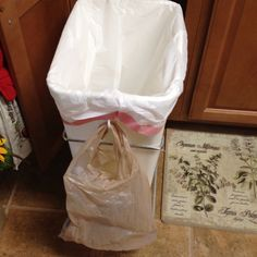 Super smart... Put a plastic hook on the side of trash can and hang plastic grocery bag. Then when you have smelly left overs (like tuna or meat scraps) you can take the small bag out and not waste a whole garbage bag!