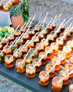 Pimm's Cups, an English summer libation, were served in glass yogurt jars with striped straws during Aneta and Phil's wedding cocktail hour.