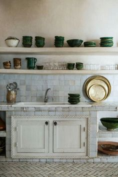 Antique, modern kitchen with green pottery