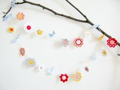 Emilia Flower Garland by emma lamb | Crocheting Pattern - Looking for your next project? You're going to love Emilia Flower Garland by designer emma lamb. - via @Craftsy