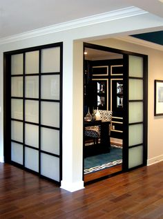 Create room separation and an elegant dining space with sliding glass doors. These frosted glass, black frame finish, pentagon frame design doors compliment both rooms beautifully!