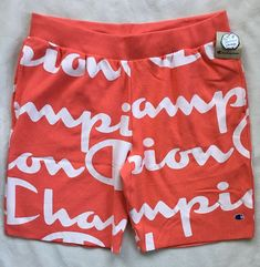 Cotton-rich heavyweight fleece with brushed interior. Cut-off hem will naturally roll after washing. cotton and polyester. Champion Wear, Coral Shorts, Script Logo, Pj Sets, Short Cuts, Cut Off, Weave, Sportswear, Active Wear
