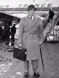 excellent candid of Tyrone Power with Air France plane 738-20