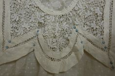 The collar of a white dress worn by a bride for her wedding in 1903. Collection: Royal Pump Room/Harrogate Museums.