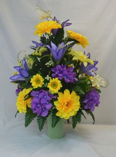 Yellow, Purple, Lavender, Cemetery Arrangement. , Autumn Cone Flower, Cone Arrangement,Grave, Tombstone arrangement, Cemetery flowers. +++++  Cherish the memories of your loved one with one of our Cemetery Cone Arrangements of lilies, mums. It is an elegant way to honor your loved one. This cone flower arrangement can be fitted to any sized of vase and it can remain in place for extended periods of time.  +++++  Material: Artificial Silk  +++++  For more floral arrangements and more, please…