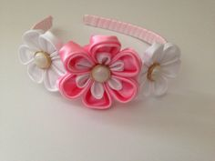 """Sweet and beautiful this flower headband made in the Japanese art of kanzashi will add charm to any occasion. Every petal is individually cut and folding to create this unique headband  Size: 2"""" middle flower 1.5"""" smaller flowers   If you would like this headband in different color or any other custom order please do not hesitate to contact me"""
