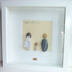 wedding pebble art bride with veil both are holding hands with their child place and date of wedding written at the top left
