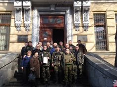 """""""Activists, Soldiers Move to Protect Libraries in Ukraine"""" -- Photo shows activists and soldiers rallied by the Ukrainian Library Association in front of the National Parliamentary Library. Click through for another photo and a hopeful story."""