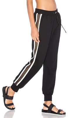 WORK by Lovers + Friends On the Line Track Pant by Lovers + Friends. Sheer mesh side panel with tuxedo stripe accent. Designer Leggings, Dance Outfits, Sport Outfits, Sport Fashion, Fitness Fashion, Sport Style, Revolve Clothing, Latest Fashion Clothes, Lounge Wear