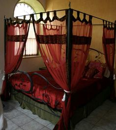 Gorgeous red and black 4 poster bed