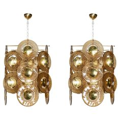 Pair of Rare Modernist Murano Disc Chandeliers Attributed to Gino Vistosi | From a unique collection of antique and modern chandeliers and pendants  at https://www.1stdibs.com/furniture/lighting/chandeliers-pendant-lights/