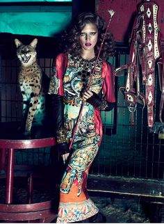 """Any fashion editorial featuring exotic animals catches our eye. This shoot, entitled """"Wild At Heart,"""" from Quebec magazine Dress to Kill is certainly no exception!  Kim Cloutier looks just as fierce and dangerous as the tigers, snakes, and other wild animals she poses alongside in the circus-themed editorial."""