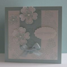 Card made in a Soft Sky colour scheme with the Stampin' Up Birthday Blossoms and Petite Petals stamp sets.