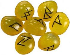 dyed Yellow Amber Rune set. Rune stones with runes carved into a stone which is then dyed amber. Set contains the 24 runes of the Elder Futhark and one blank stone. Stones can vary in size from 1/2' - 1""