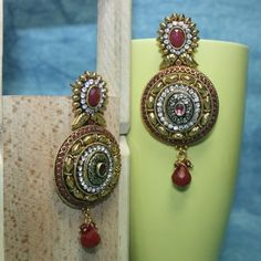 Metal carving polki earring engraved with stone and AD with red drop