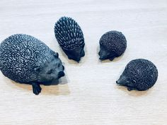 AI / Concrete figurines. A hedgehog family.