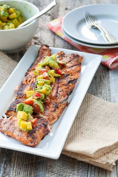 Blackened Salmon: This was great. Didn't have fresh mango but salsa was still delish. Blackened Salmon with Mango-Avocado Salsa from Against All Grain Salmon Recipes, Fish Recipes, Seafood Recipes, Chicken Recipes, Tilapia Recipes, Orange Recipes, Steak Recipes, Pizza Recipes, Potato Recipes
