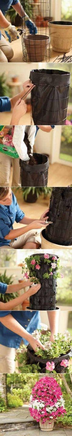 How to make a flower tower planter petunias Lawn And Garden, Garden Art, Garden Plants, Garden Club, Tower Garden, Potted Plants, Summer Garden, Garden Mulch, Diy Garden