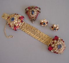 """HOBE red, clear and blue bracelet, brooch and earrings with patriotic colored rhinestones set into gold tone filigree, patent number 143,317 circa 1945, bracelet 7"""", brooch 1-3/4"""" by 1-1/2"""", earrings 1"""".  The stones are brilliant and unfoiled and the bracelet an unusual front-opening style."""