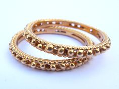 Gorgeous 18kt stacking bands by Polly Wales.