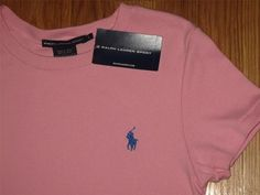 I sell all new with tags Polo Ralph Lauren clothing , & my auctions start at .99 ! Here is a women's size medium top