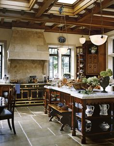 Pretty kitchen, I like the dark wood with the ,honed, marble, the gorgeous floor, and of course...La Corneau and blue and white. This kitchen is timeless.