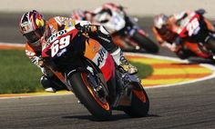 Nicky Hayden Photos Photos - A man waves to Nicky Hayden of the U.S. as he clinches the World MotoGP title after finishing third in the MotoGP race in the Ricardo Torma racetrack on October 29, 2006 in Valencia, Spain. - MotoGP of Valencia