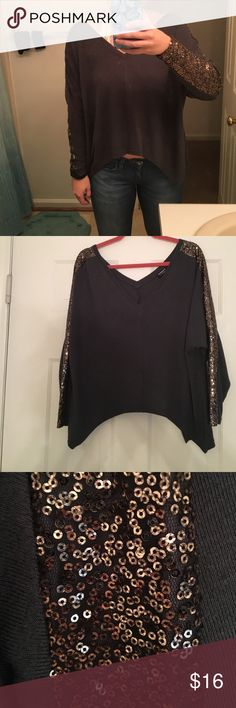 Charcoal Cropped Sweater with Sequined Sleeves super comfy charcoal sweater! detailed sleeves with sequins. slightly cropped but it's a little smaller on me bc I'm a true medium. perfect for a night out. can be dressed up or dressed down. longer on the sides and shorter in front and back Tobi Sweaters V-Necks