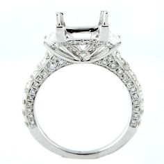 Three Stone Style with Baguettes and Round Brilliants Diamond Engagement Ring Mounting 18kt white gold semi-mount large baguette on either side of the center.  Set with round brilliants down the sides and gallery.  1.59ctw