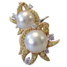 South Sea Pearl Yellow and White Diamond Ear Clips by Donna Vock | From a unique collection of vintage clip-on earrings at http://www.1stdibs.com/jewelry/earrings/clip-on-earrings/