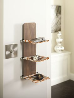 The Unity fabric shelf is a compact shelving system for small everyday items, it combines solid wood with hand-printed fabric shelves which are mounted on a hand-made steel frame, creating a seamless mix of style and practicality.