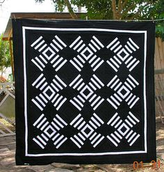 Modern #quilt:  repetitive white pattern on black