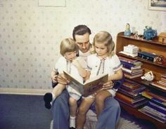 Walt Disney reading to his daughters
