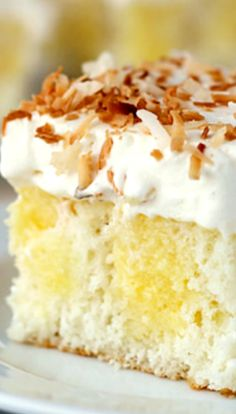 Triple Coconut Poke Cake ~ A white coconut cake with coconut pudding. Topped with Coconut whipped cream and toasted coconut.
