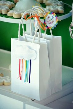 Pretty favor bags at a rainbow birthday party! See more party planning ideas at CatchMyParty.com!