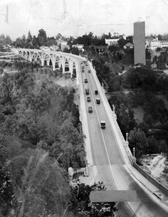 """The Colorado Street Bridge in Pasadena in 1914, a little less than a year after it was completed. (Photo: LAPL). It did not take long for the famed bridge to develop a darker reputation as a """"bridge of suicide,"""" By November of 1924, fourteen people had already leaped to their deaths."""