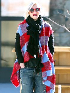 We LOVE how the fabulous Gwen Stefani incorporated RED into her sweater, lipstick and, most importantly, her eyewear! These round red sunnies rock!