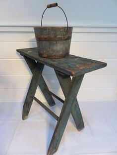 Small antique Pennsylvania sawbuck table in original blue.